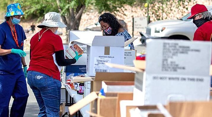 Earlier this year, as part of Public Service Recognition Week, the Nothern Arizona VA Health Care collected and delivered 4,500 pounds  of food, cleaning supplies and water to 80 veteran families of the Hopi Tribe and Tewa people. (Photo courtesy of U.S. Dept. of Veteran Affairs)