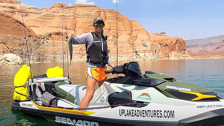 Kim from Tucson reeled in a 25.5 pound Striped Bass while on her Sea-Doo Fishpro Adventure at Lake Powell.(Screenshot/YouTube)