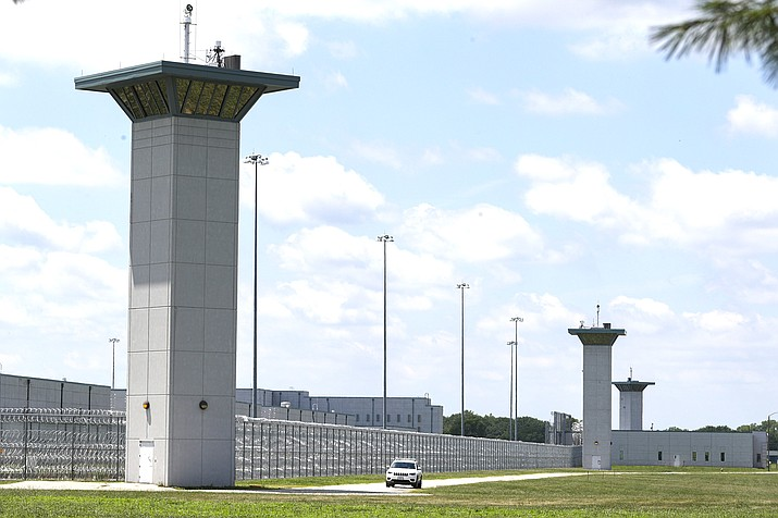 The federal prison complex in Terre Haute, Indiana. Indiana State Police agreed Aug. 14, 2020 to stop blocking roads to the prison where federal executions resumed last month and are set to continue, backing down after anti-death penalty activists said in a lawsuit the roadblocks impeded their speech rights. (AP Photo/Michael Conroy, File)