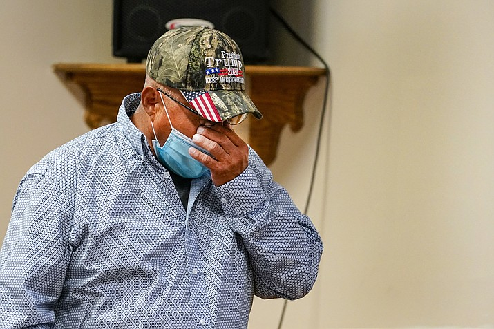 Daniel Lee, father of Tiffany Lee, wipes his face as he leaves the podium after a statement by his attorney at the federal prison complex in Terre Haute, Indiana, Aug. 26. Lezmond Mitchell, the only Native American on federal death row, was executed at 6:29 p.m. for the slaying of Lee's 9-year-old daughter Tiffany and her grandmother nearly two decades ago. (AP Photo/Michael Conroy)