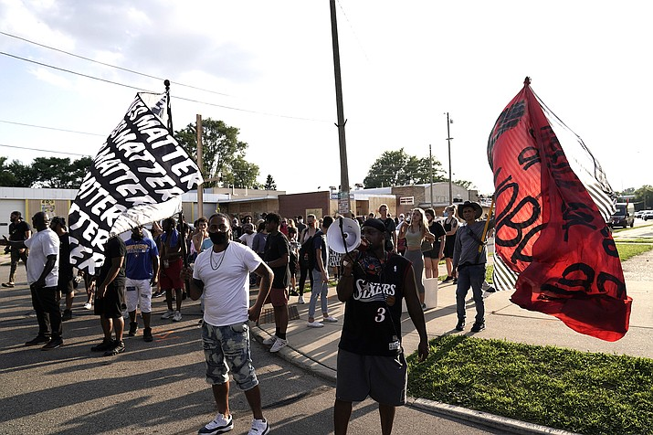 Protesters prepare to march against the Sunday police shooting of Jacob Blake Thursday, Aug. 27, 2020, in Kenosha, Wis. Until the police shooting of Blake, the bedroom community of Kenosha has been largely untouched by the level of demonstrations that had been seen in nearby Milwaukee and Chicago since the death of George Floyd.(AP Photo/Morry Gash)