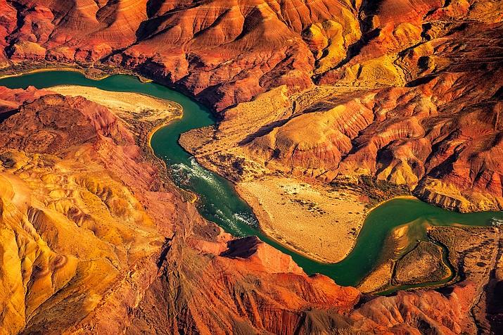 The Colorado River runs through the Grand Canyon. (Adobe Stock)