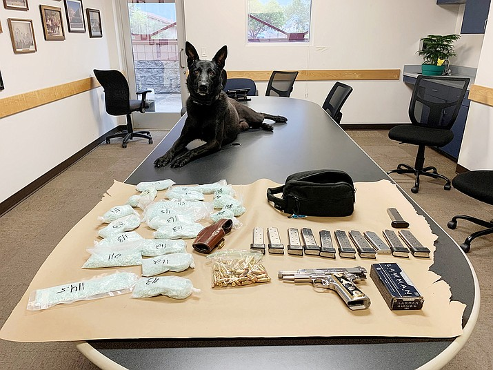 During a traffic stop on Tuesday, Aug. 25, 2020, Cottonwood police K9, Kratos, alerted officers to a cache of 15,000 to 20,000 fentanyl pills with a street value of about $600,000. Items also seized included a handgun, magazines and numerous 45-caliber and 9mm bullets. (Cottonwood Police Department/Courtesy)
