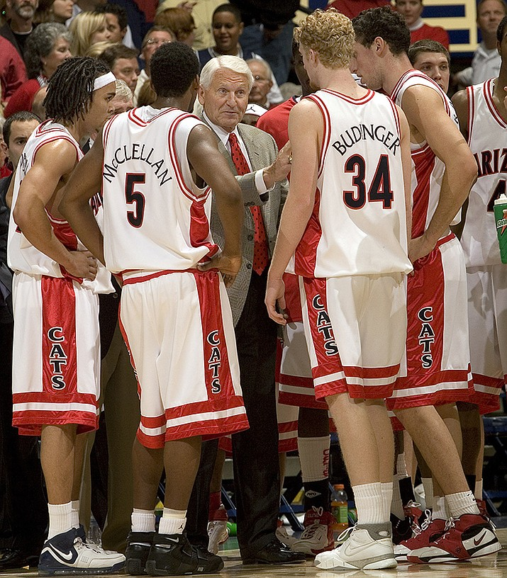 In this Dec. 20, 2006, file photo, Arizona head coach Lute Olson, center, talks to his players, from left to right, Daniel Dillon, Jawann McClellan (5), Chase Budinger (34) and Ivan Radenovic during the second half of a college basketball game against Memphis in Tucson, Ariz. Olson, the Hall of Fame coach who turned Arizona into a college basketball powerhouse, has died at the age of 85. Olson's family said he died Thursday, Aug. 27, 2020. The family did not provide the cause of death. (John Miller, AP File)