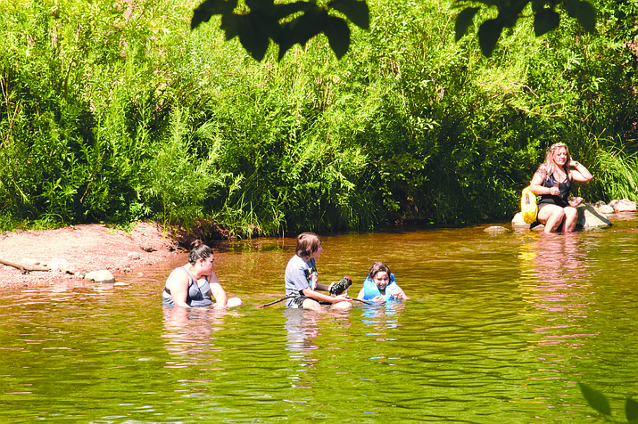 Visitors enjoy the water at Red Rock Crossing on a recent Sunday. A sewage spill upstream caused E.Coli levels to spike at some test sites along Oak Creek. A sewage spill occurred Aug. 4. VVN/Jason W. Brooks
