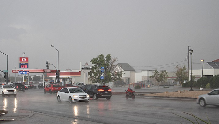 Cars navigate on Stockton Hill Road in Kingman on Aug. 18, the last time rain fell in Kingman. Flash flood warnings were in effect when the Miner went to press on Saturday, Aug. 29. (Miner file photo)