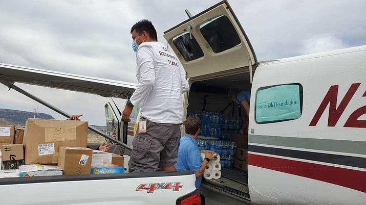 Justin Tapaha from the Special Diabetes program helps offload supplies donated by Arizona nurses from the Navajo and Hopi Community Relief. The supplies were flown into Kayenta, Arizona by the Airserv and Navajo & Hopi Families COVID-19 Relief Fund Navajo Airbridge program. (Photo courtesy of Navajo & Hopi Families COVID-19 Relief Fund)