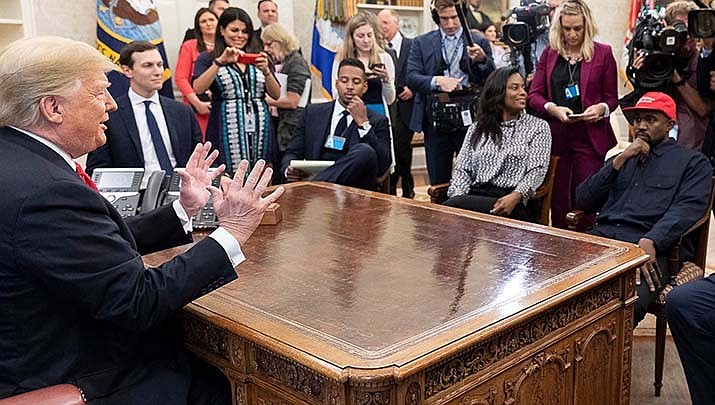 Singer Kanye West's attempt to get his name on the presidential election ballot in Arizona has been met with a lawsuit. West, right, is shown meeting with President Donald Trump in this Oct. 11, 2018 file photo. (Official White House photo/Public domain)