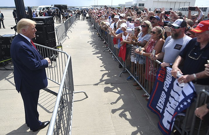 President Donald Trump talks to the crowd at Wilmington International Airport in Wilmington, N.C., Wednesday, Sept. 2, 2020. Trump was visiting Wilmington to declare it the first World War II Heritage City and to meet with World War II veterans in a private, invitation only event at the Battleship North Carolina. (Matt Born/The Star-News via AP)