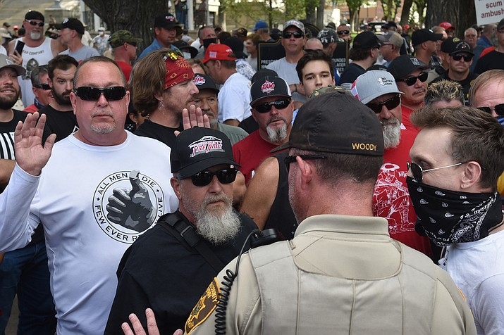 A Yavapai County Sheriff's deputy intervenes as tensions rise between Black Lives Matter protesters and armed counterprotesters at the Yavapai County Courthouse plaza on Friday, Sept. 4, 2020. Local law enforcement were present throughout the event. (Jesse Bertel/Courier)