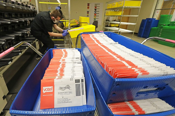 In this Aug. 5, 2020, file photo, vote-by-mail ballots are shown in sorting trays at the King County Elections headquarters in Renton, Wash., south of Seattle. In every U.S. presidential election, thousands of ballots are rejected and never counted. They may have arrived after Election Day or were missing a voter's signature. That number will be far higher this year as the coronavirus pandemic forces tens of millions of Americans to vote by mail for the first time. (AP Photo/Ted S. Warren, File)