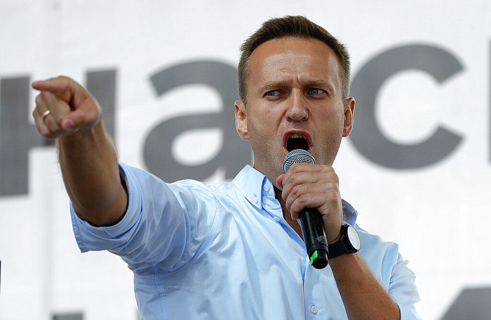 In this July 20, 2019, file photo, Russian opposition activist Alexei Navalny gestures while speaking to a crowd during a political protest in Moscow, Russia. The German hospital treating Russian opposition leader Alexei Navalny says he has been taken out of an induced coma and is responsive. German experts say Navalny, who fell ill Aug. 20 on a domestic flight in Russia, was poisoned with a substance belonging to the Soviet-era nerve agent Novichok. (AP Photo/Pavel Golovkin, File)