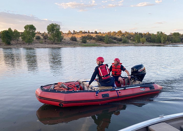 Prescott firefighter Nicholas Bomar, left, and Engineer Tom Cooley make their way toward people in need of help after a microburst hit Watson Lake on Saturday, Sept. 5, 2020, in Prescott. (Prescott Fire/Courtesy)