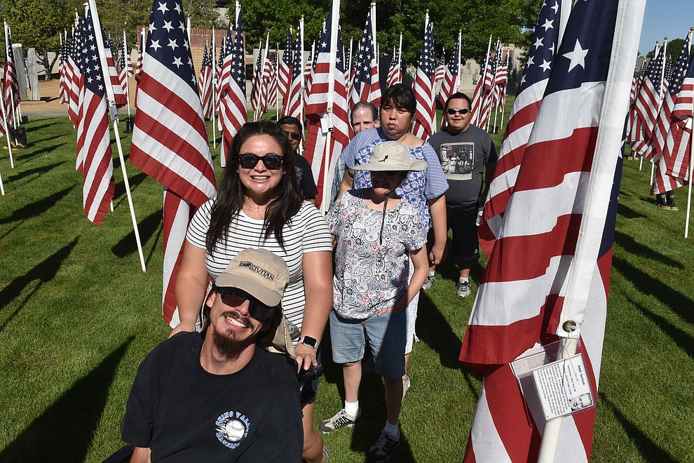 Caregiver Flor Villavicencio, second from front, leads a group from the Learning Center in Chino Valley on their annual tour of the commemorative flags, on Friday, Sept. 4, 2020. (Jesse Bertel/Courier).