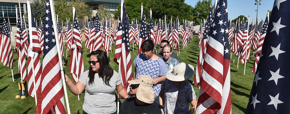 Caregiver Flor Villavicencio, left, leads a group from the Learning Center in Chino Valley on their annual tour of the commemorative flags, on Friday, Sept. 4, 2020. (Jesse Bertel/Courier).