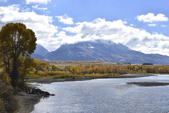 Emigrant Peak is seen rising above the Paradise Valley and the Yellowstone River near Emigrant, Montana. (AP Photo/Matthew Brown,
