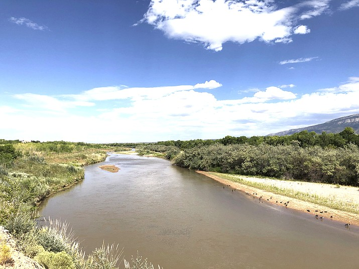 Sand bars and vegetation have helped to narrow the Rio Grande as it flows through Rio Rancho, New Mexico, on Monday, Aug. 31, 2020. New Mexico and other southwestern states have been dealing with dry conditions and warmer temperatures this summer. (AP Photo/Susan Montoya Bryan)