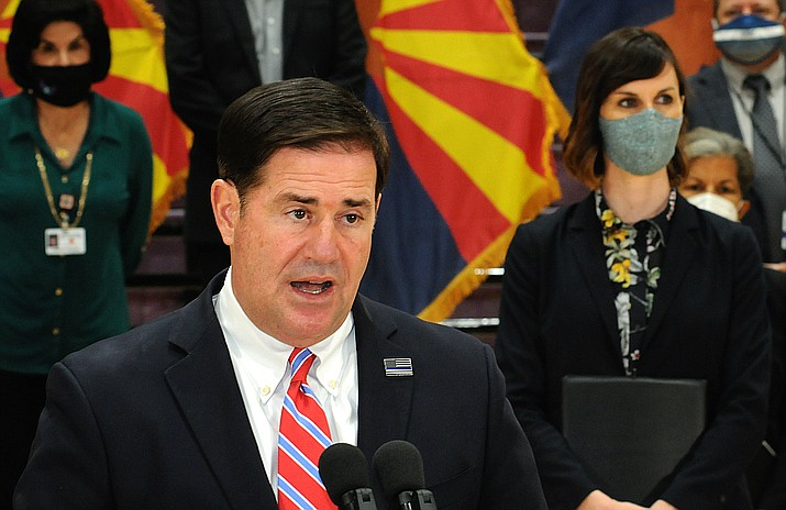 Gov. Doug Ducey said Thursday it's up to Congress and not the state to deal with the fact that unemployment assistance is on the verge of being cut by more than half. With him is state schools chief Kathy Hoffman. (Capitol Media Services photo by Howard Fischer)