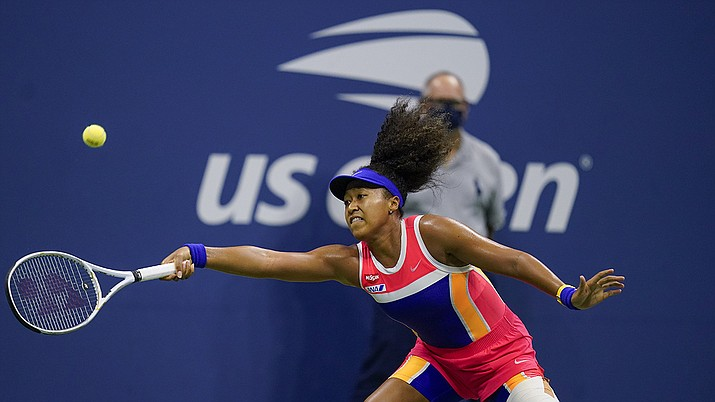 Naomi Osaka, of Japan, returns a shot to Jennifer Brady, of the United States, during a semifinal match of the US Open tennis championships, Thursday, Sept. 10, 2020, in New York. (Seth Wenig/AP)