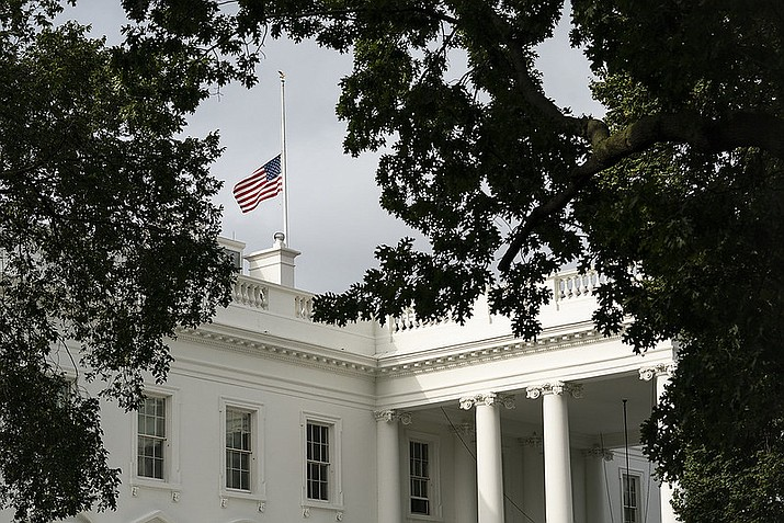 An American flag flies at half-staff over the White House in observance of the terrorist attacks on the United States on Sept. 11, 2001. (Official White House photo/Public domain)