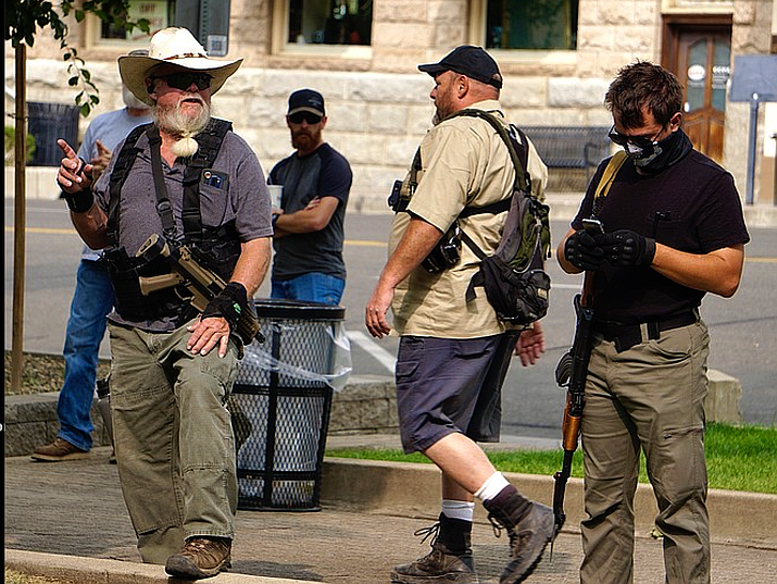 Armed counterprotesters were on the plaza in downtown Prescott Friday, on rumors that a Black Lives Matter group was going to be there. The BLM contingent did not attend. (Aaron Valdez/Prescott Daily Courier)