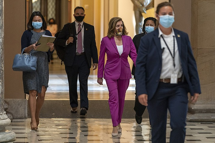 House Speaker Nancy Pelosi of Calif., center, walks to her office, Monday, Sept. 14, 2020, on Capitol Hill in Washington. (Jacquelyn Martin/AP)