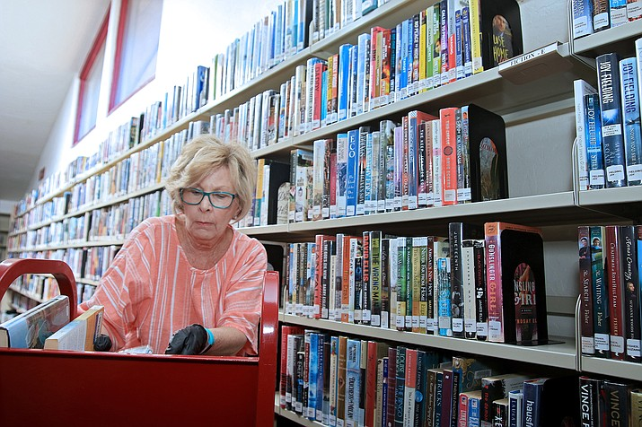 Pictured is Teri Tobey, library clerk, re-stocking and organizing books at the Chino Valley Public Library. The library is located at 1020 W. Palomino Rd. in Chino Valley Road. You can call them at 928-636-2687. (Town of Chino Valley/Courtesy)