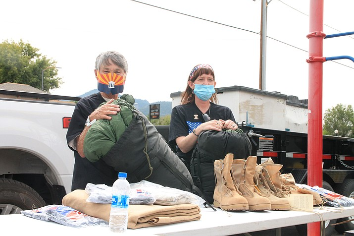 Shelley Wrigley and Kimberly Thurston with American Legion Cordova Post 13 in Williams (left), hand out blankets, boots, socks and other cold weather items to veterans during the High Country Stand Down in Williams Sept. 11. (Loretta McKenney/WGCN)
