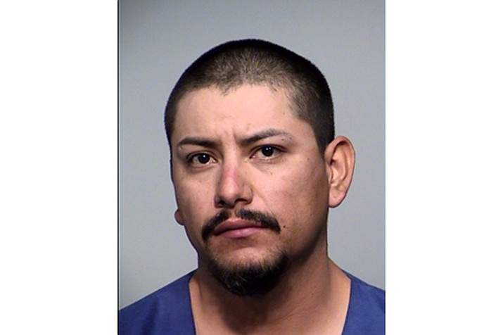 In this undated photo provided by the Prescott Valley (Arizona) Police Department, is Alfredo Saldivar. Police on Monday, Sept. 14, 2020, justified the use of an attack dog on a suspect who appeared on a police body cam video to be complying with officers. The Prescott Valley Police Department said in a statement that the use of the canine was necessary during the May arrest because Saldivar, 28, who allegedly had been driving erratically and at high speeds, hesitated before obeying orders to stand up. The video has been gaining attention online since its release late last week. (Prescott Valley Police Department via AP)