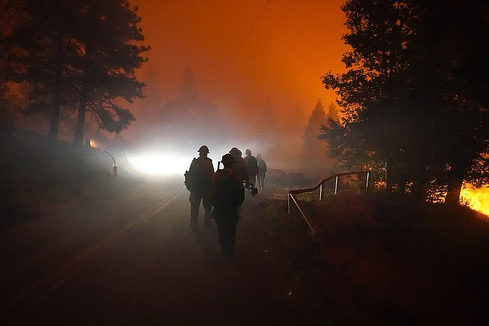 Members of the Laguna Hotshots, out of the Cleveland National Forest, walk on a road while fighting the Creek Fire, Sunday, Sept. 6, 2020, in Big Creek, Calif. (AP Photo/Marcio Jose Sanchez)