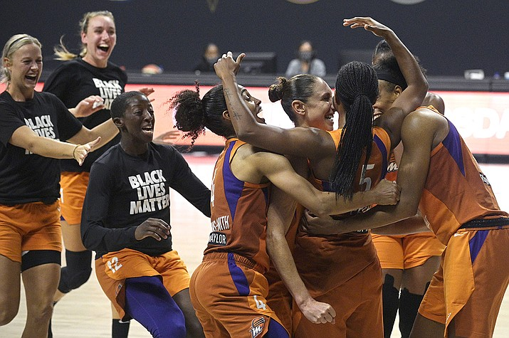 Phoenix Mercury guard Shey Peddy (5) is swarmed by teammates after Peddy scored the game-winning shot as time expired during a WNBA basketball first-round playoff game agains the Washington Mystics, Tuesday, Sept. 15, 2020, in Bradenton, Fla. (Phelan M. Ebenhack/AP)