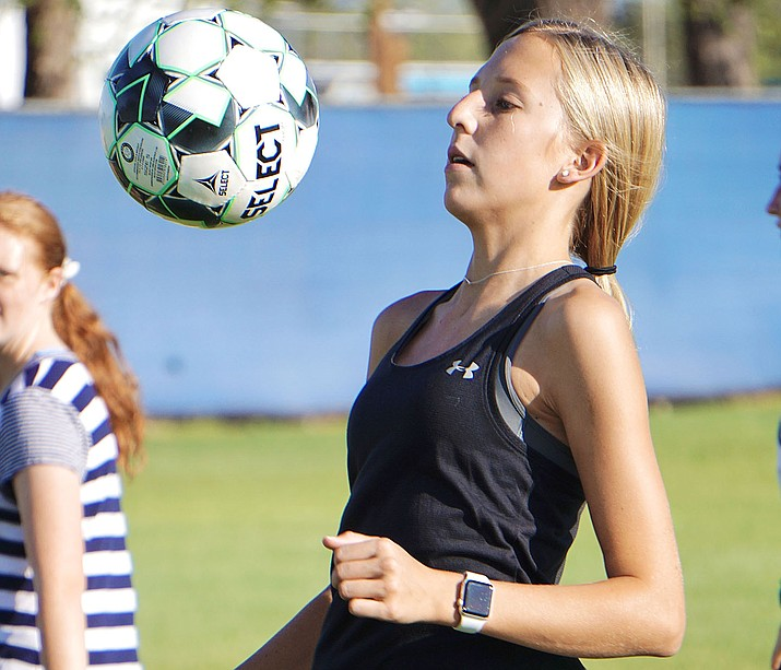 Chino Valley forward Kaitlyn Roskopf controls the ball with her chest during a drill at a team practice on Tuesday, Sept. 15, 2020, in Chino Valley. (Aaron Valdez/Courier)