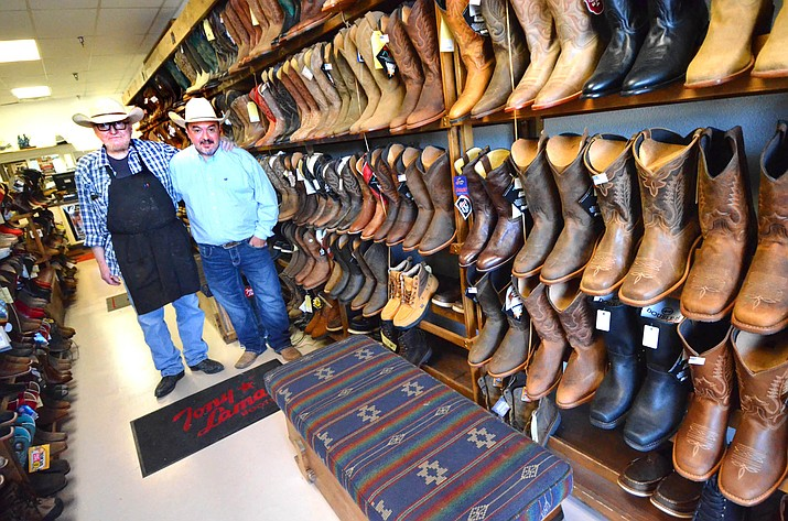 Casey Anderson, right, and his dad, Stanley, pose for a photo in the new Casey's Cowboy Shop in the Safeway plaza on Wednesday afternoon. VVN/Vyto Starinskas