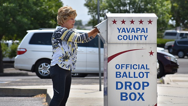 A voter inserts her ballot into a drop box at the Prescott Valley Civic Center on Primary Election Day, Tuesday, Aug. 4, 2020. Using a drop box ensures quick delivery and saves the county 60 cents per ballot. General Election Day will be held Tuesday, Nov. 3, 2020. (Courier file)