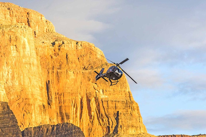 The Associated Press reports that several companies known for scenic tour flights to the Las Vegas Strip and Grand Canyon have cut significant slices of their staff to mirror business demand, according to documents filed with Nevada employment officials. (Photo/Adobe stock)