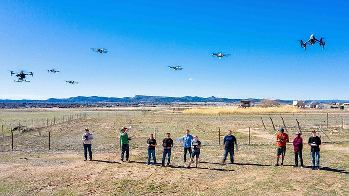 Yavapai College students watch their drones hover in the air for a program that has been selected to use for training by the Federal Aviation Administration (Yavapai College/Courtesy)