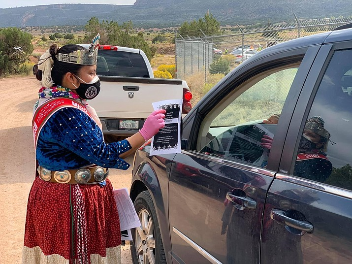 On Sept. 22, the Navajo Nation re-issued stay-at-home orders and a 57-hour weekend lockdown for the Nation because of rising COVID-19 cases. Above: Miss Navajo Nation Shaandiin Parrish helped pass out information about the 2020 Census as the president's office handed out food and care packages in the communities of Manuelito, Tse si Ani and Oak Springs. (Photo/OPVP)