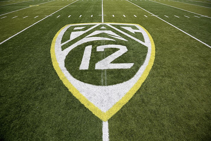 In this Oct. 10, 2015 photo, a PAC-12 logo is displayed on the field before an NCAA college football game between Washington State and Oregon in Eugene, Ore. (Ryan Kang/AP, File)