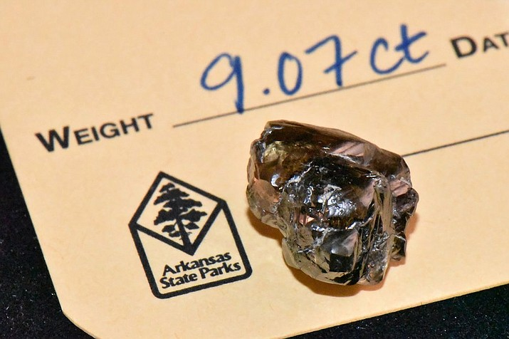 In this Wednesday, Sept. 23, 2020, photo provided by The Arkansas Department of Parks, Heritage and Tourism, is a 9.07 carat diamond found by Kevin Kinard at Crater of Diamonds State Park on Sept, 7, 2020, in Murfreesboro, Ark. Kinard of Maumelle found the second-largest diamond in the 48-year history of Crater of Diamonds State Park on Labor Day, according to a news release from Arkansas State Parks. (Waymon Cox/Arkansas Department of Parks, Heritage and Tourism via AP)