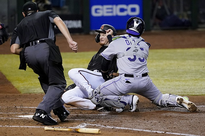 Arizona Diamondbacks Pavin Smith is tagged out at the plate by Colorado Rockies catcher Elias Diaz during the fifth inning of a baseball game, Saturday, Sept. 26, 2020, in Phoenix. Smith was trying to score on a base hit by Jon Jay. (Matt York/AP)