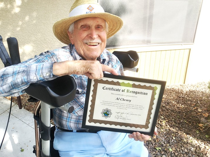 """Al Cheney poses with the city proclamation declaring Sept. 19 as """"Al Cheney Day."""" (Courtesy)"""