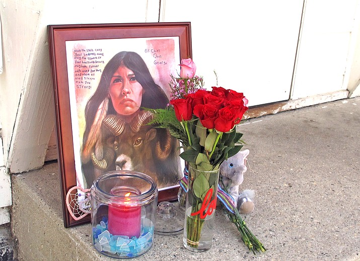 A makeshift memorial to Savanna Greywind featuring a painting, flowers, candle and a stuffed animal is seen in Fargo, North Dakota. On Sept. 21, The House of Representatives passed Savanna's Act that will create new guidelines for reporting cases of missing and murdered Indigenous people. (AP Photo/Dave Kolpack, File)