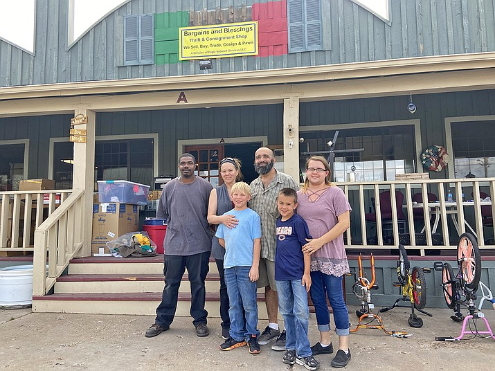 Jane and Jeff Miller (center) pose with their children and staff at Bargains and Blessings Thrift Store. (Wendy Howell/WGCN)
