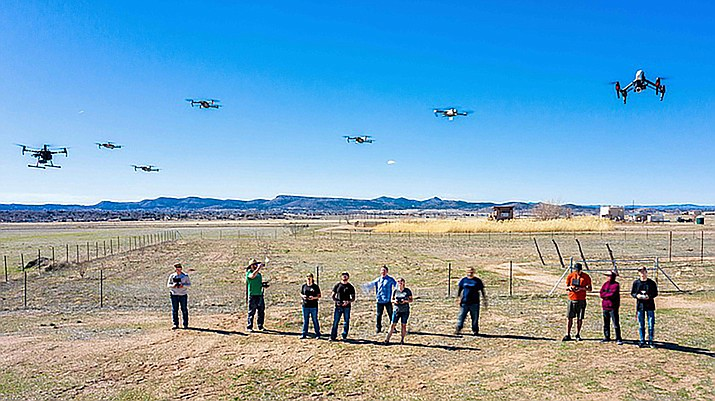 Yavapai College students watch their drones hover in the air for a program that has been selected to use for training by the Federal Aviation Administration (Photo/Yavapai College)
