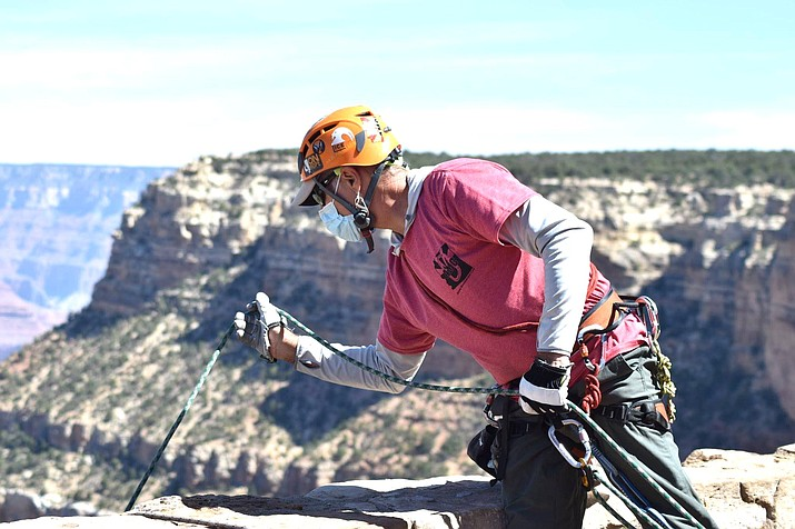 Arizona Mountaineering Club volunteer Scott Kuchman helps volunteers during the clean-up.(Photo/NPS)