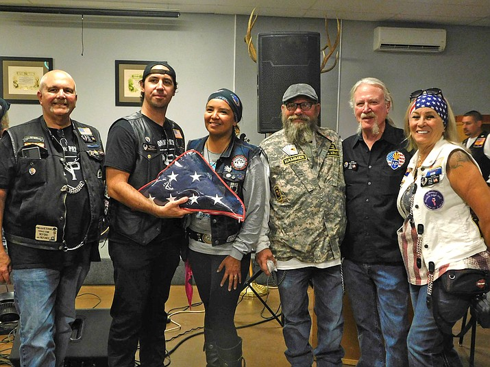 Geri Hongeva-Camarillo (center) holds the Nation of Patriots Flag during its homecoming ceremony Sept. 12 in Chandler, Arizona. Hongeva-Camarillo is the guardian of the Code Talker Flag that is transported throughout the country representing Native American veterans.  (Submitted photo)