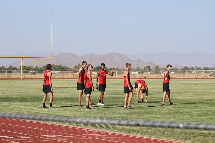 The Lee Williams High School boys cross-country team warms up before a meet on Wednesday, Sept. 23. The Volunteers finished 12th at the Mark Weston Invitational meet in Lake Havasu City on Saturday, Sept. 26. (Miner file photo)