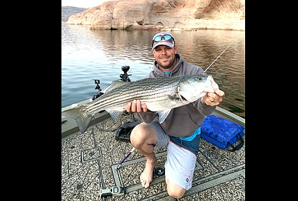 Scott Meyer with his big striper caught at Lake Powell. (Submitted photo)