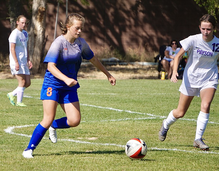 Chino Valley midfielder Delyn Bannan (8) prepares to shoot the ball during the Cougars' 8-0 win over Payson on Thursday, Sept. 24, 2020, in Chino Valley. The Chino Valley girls soccer team has been and will continue to share the boys soccer field until their own field is complete sometime in 2021, according to Foster. (Aaron Valdez/Review)