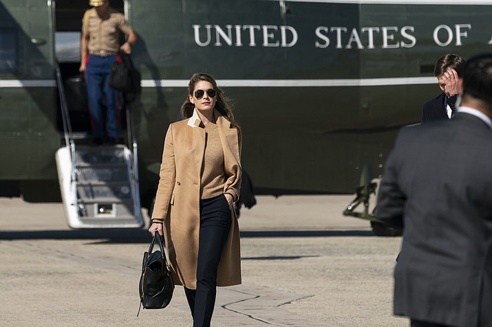 Counselor to the President Hope Hicks walks from Marine One to accompany President Donald Trump aboard Air Force One as he departs Wednesday, Sept. 30, 2020, at Andrews Air Force Base, Md. President Donald Trump has been infected with the coronavirus, shortly after Hicks got sick too. (Alex Brandon/AP)